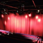 Stage lighting spotight on curtains
