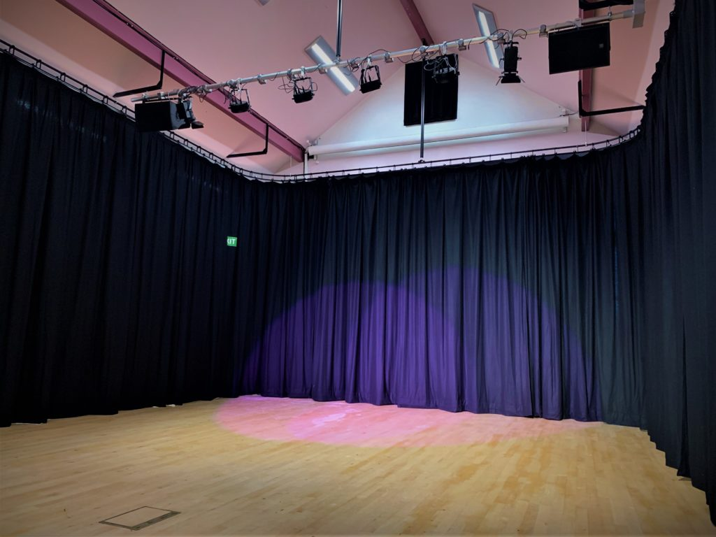 Grammar School stage curtains and lighting installation